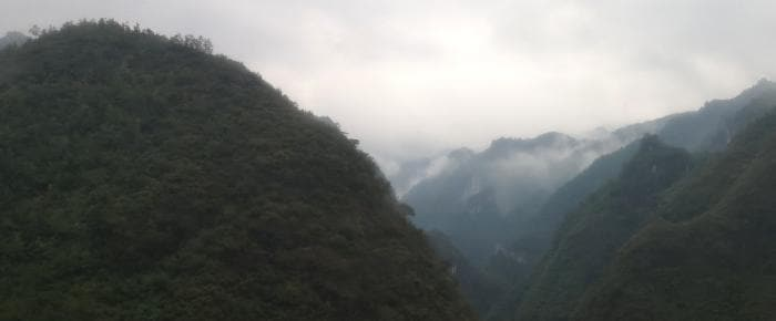 Douliu, Guizhou, China misty mountains